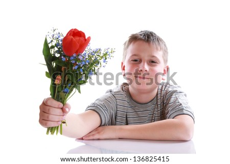 Happy teenager with bouquet of flowers on a white background - stock photo