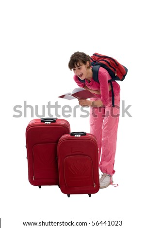 Happy teenager with huge luggages reading book while waiting a taxi, she is laughing - stock photo