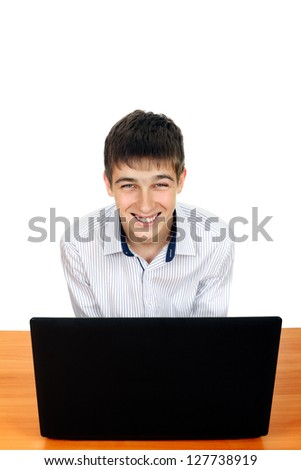 Happy Teenager with Laptop at the Desk. Isolated on the white background