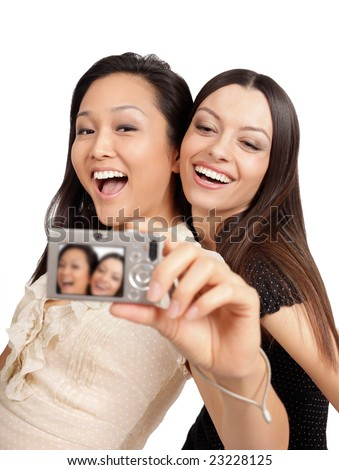 Happy teenagers taking their own picture - stock photo