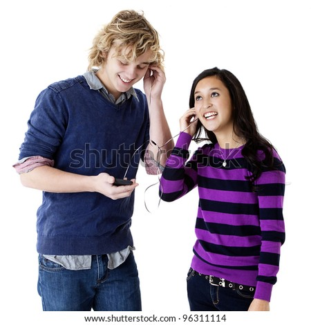 happy teens listening to music together - stock photo