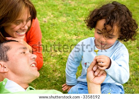 happy tender family smiling and having fun outdoors - stock photo