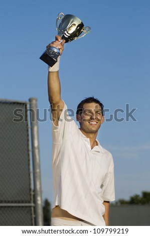 Happy tennis player celebrating victory