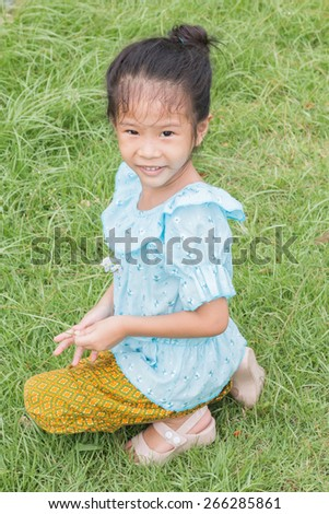 Happy Thai little girl in Thai traditional dress  - stock photo
