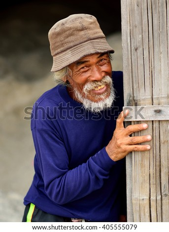 Happy thai Man Smiling For The Camera Concept . portrait of laughing old man with gray beard - stock photo