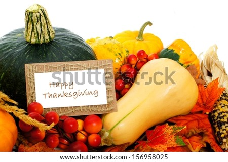 Happy Thanksgiving card among autumn vegetables on a white background - stock photo