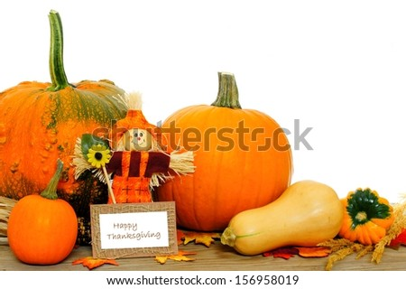 Happy Thanksgiving card with scarecrow and harvest vegetables - stock photo