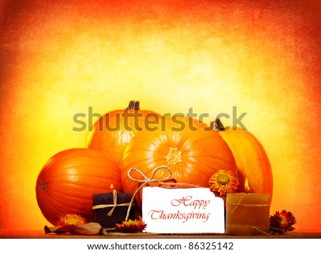 Happy thanksgiving day greeting card with traditional pumpkin and candles, holiday table setting - stock photo