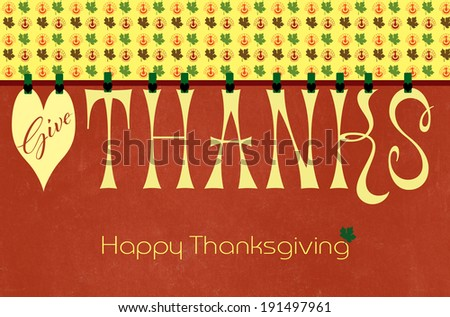 Happy Thanksgiving, Give Thanks, party bunting letters hanging from pegs on a line with turkey and Autumn Fall leaf pattern against an orange grunge background for greeting card or wallpaper. - stock photo