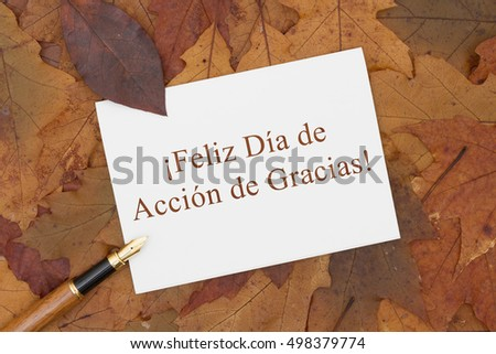 Happy thanksgiving greeting card spanish some stock photo 498379774 happy thanksgiving greeting card in spanish some fall leaves pen and a greeting card m4hsunfo
