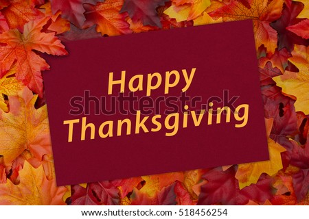 Happy thanksgiving greeting card some fall stock photo royalty free happy thanksgiving greeting card some fall leaves and a greeting card with text happy thanksgiving m4hsunfo Choice Image