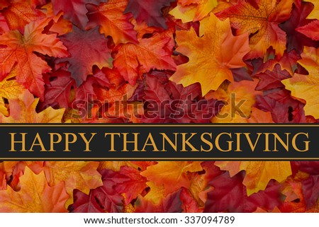 Happy Thanksgiving Greeting, Fall Leaves Background and text Happy Thanksgiving - stock photo
