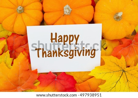 Happy Thanksgiving Greeting, Some fall leaves and pumpkins with text Happy Thanksgiving on a greeting card