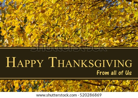 Happy Thanksgiving Greeting, Some fall leaves with text Happy Thanksgiving from all of us