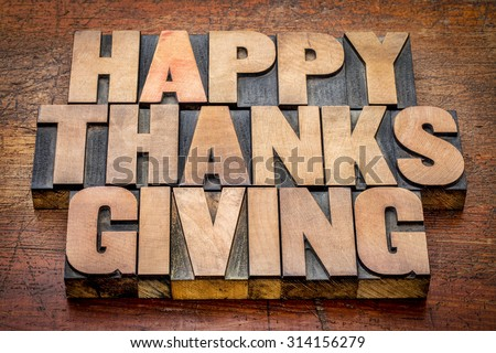 Happy Thanksgiving greetings card or sign -  text in vintage letterpress wood type blocks against rustic wood - stock photo