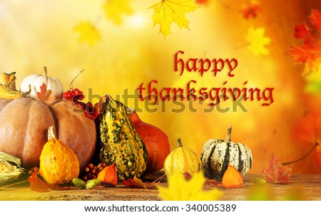 Happy Thanksgiving  - harvest background with pumpkin and dry leaves - stock photo
