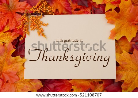 Happy thanksgiving message autumn leaves beige stock photo 521108707 happy thanksgiving message autumn leaves with a beige greeting card with text with gratitude at m4hsunfo Choice Image