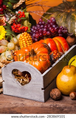 Happy Thanksgiving still life. Fruits, nuts and vegetables, fall crop on  the table - stock photo
