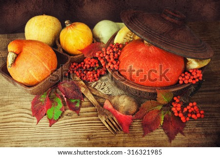 Happy Thanksgiving still life. Fruits, nuts and vegetables on the table. - stock photo