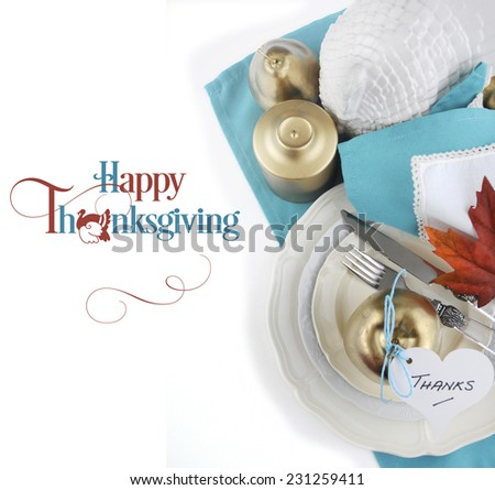 Happy Thanksgiving table place setting in pale aqua blue and white theme with gold fruit and candle, and sample text. - stock photo