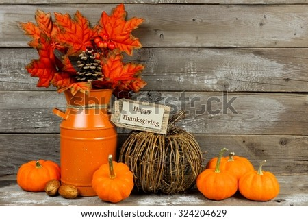 Happy Thanksgiving tag, pumpkins and autumn home decor with rustic wood background - stock photo