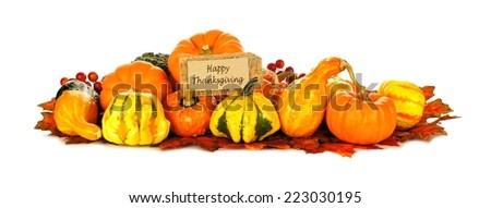 Happy Thanksgiving tag with a group of autumn pumpkins and vegetables over white - stock photo