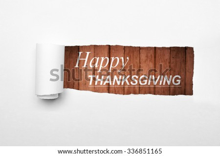 Happy thanksgiving with wooden background on the paper tear - stock photo
