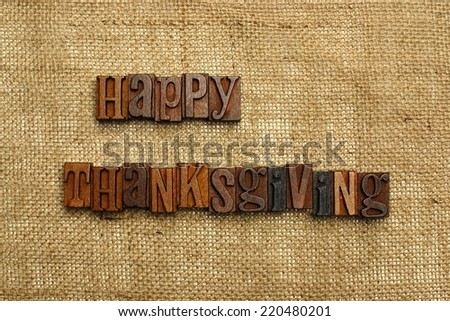 Happy Thanksgiving written with wooden letters on burlap - stock photo