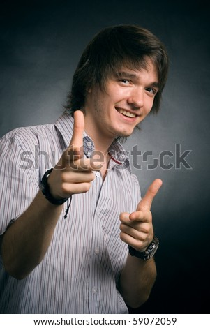Happy the man specifies a finger - stock photo
