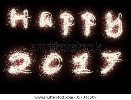 Happy 2017. The words are written with fireworks sparklers on black background - stock photo