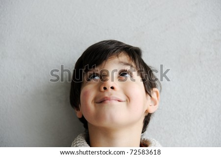 Happy thinking boy - stock photo