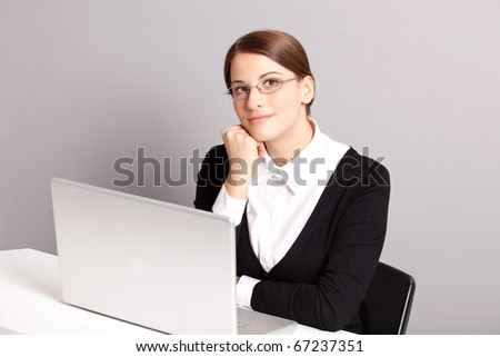 Happy thinking woman in the office