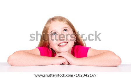 Happy thoughtful child or pre-teen looking up - stock photo