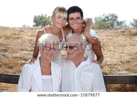 happy three generations family portrait - stock photo