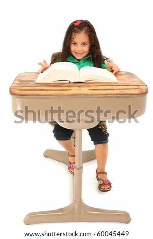 Happy three year old hispanic girl sitting in school desk over white background. - stock photo