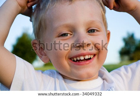 Happy three years old boy goofing around - stock photo