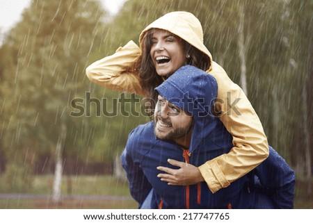 Happy time despite bad weather - stock photo
