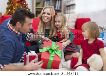 Happy time during the Christmas for young family  - stock photo