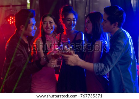Happy time, Group of friends having fun. young people laugh. celebrating New Year together. Group of beautiful young people with champagne at party