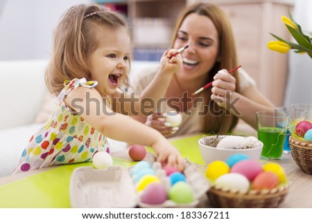 Happy time while painting easter eggs   - stock photo