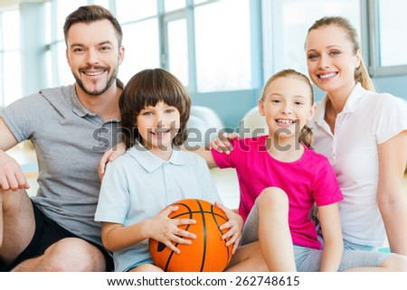 Happy to be a family. Happy sporty family bonding to each other while sitting in sports club together   - stock photo