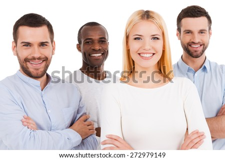 Happy to be a team. Four happy young people in smart casual wear looking at camera while bonding to each other and standing against white background - stock photo