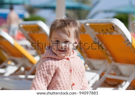 Happy toddler at resort hotel area