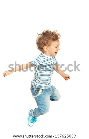Happy toddler boy jumping isolated  on white background