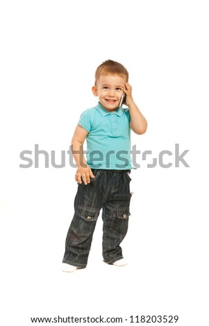 Happy toddler boy talking by phone mobile isolated on white background - stock photo
