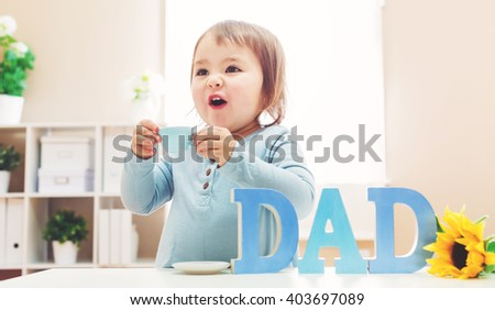 Happy toddler girl celebrating Father's Day - stock photo