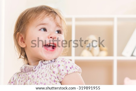 Happy toddler girl with a great big smile - stock photo