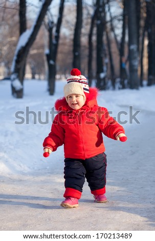 Happy toddler  in winter sunny day - stock photo