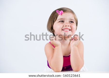 Happy toddler smiling with joy - stock photo