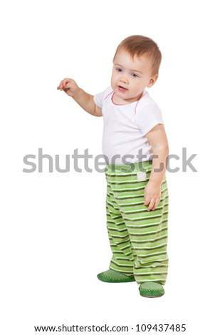 Happy toddler standing over white background